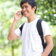 Asian handsome young guy speaking on telephone — Foto de Stock