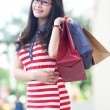 Stock Photo: Asiwomwith shopping bag