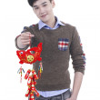 Asian Teenager boy celebrate Chinese new year festival, isolated in white — Stock Photo