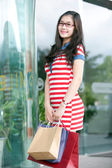 Asian woman with shopping bag in department store — Stock Photo