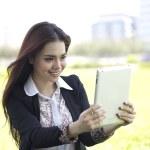 Beautiful Asian woman using iPad tablet to take photo — Stock Photo #21680801