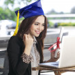 Beautiful Asian woman show her graduation through webcam chat — Stock Photo