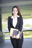 Beautiful Asian college student with laptop at campus — Stock Photo