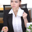 Headache and Stress at work. Young professional woman stressed and tired with headache sitting at office desk, holding medicine pills — 图库照片