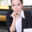 Headache and Stress at work. Young professional woman stressed and tired with headache sitting at office desk. — Stock Photo