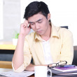Stressful Asian young businessman in the office — Stock Photo