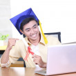 Online training course - Young Asian graduation student guy - Stock Photo