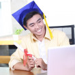 Online training course - Young Asian graduation student guy — 图库照片
