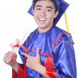 Young Asian graduation student guy - isolated on white - Stock Photo