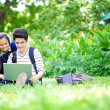 Young Asian students with computer and smile in outdoor — Stock Photo