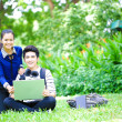 Young Asian students with computer and smile in outdoor — Lizenzfreies Foto