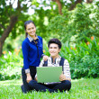 Young Asian students with computer and smile in outdoor — Foto Stock