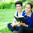 Young Asian students with books and smile in outdoor — Stok fotoğraf