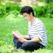 Young handsome Asian student with books and smile in outdoor — 图库照片