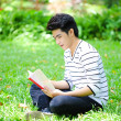 Young handsome Asian student with books and smile in outdoor — Stok fotoğraf