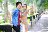 Young Asian couple in outdoor — Stock Photo