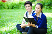 Young Asian students with books and smile in outdoor — Stock Photo