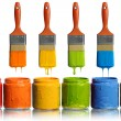Paintbrushes Dripping into Paint Containers — Stock Photo #13325879