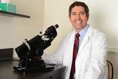 Hispanic Researcher Using Microscope — Stock Photo