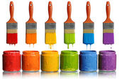 Paintbrushes Dripping into Paint Containers — Stock Photo