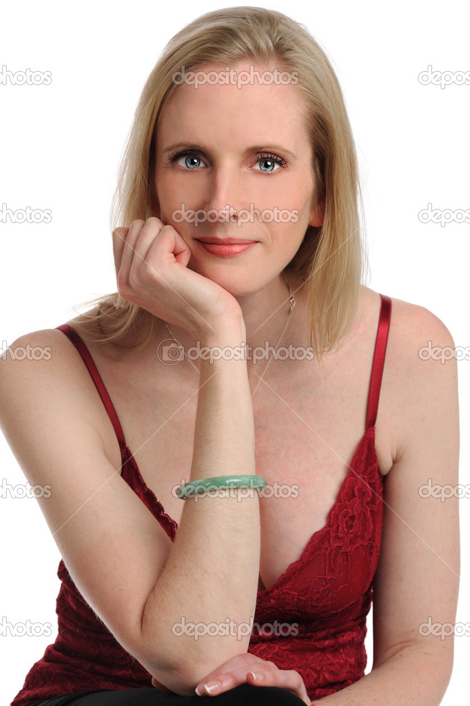 Portrait of young woman with hand on chin isolated over white background  Stock Photo #13325573