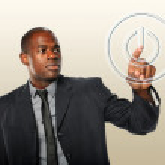 Businessman Touching Power Button — Stock Photo #13389512
