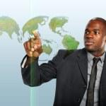 Businessman Touching World Hologram — Stock Photo #13389517