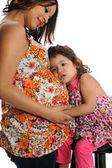 Madre hispana embarazada con hija — Foto de Stock