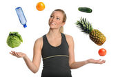 Woman Juggling Fruits Vegetables and Water — Stock Photo