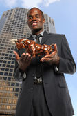 Businessman Holding Bull — Stok fotoğraf
