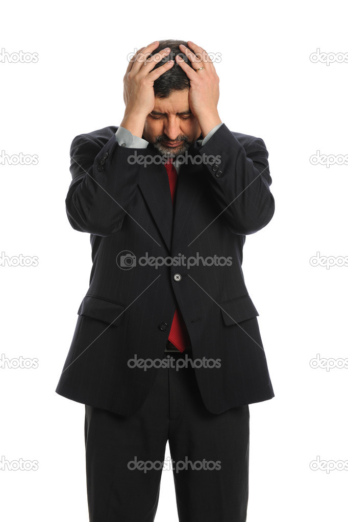 Portrait of Hispanic businessman stressed with hands on head isolated over white background — Stock Photo #13390431