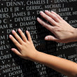 Hand of Adult and Child Touching Names at War Memorial — Stock Photo