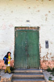 Young Girl Walking by Old Door — Stock Photo