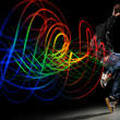 ������, ������: Dancer with Waves of Light Over Black Background