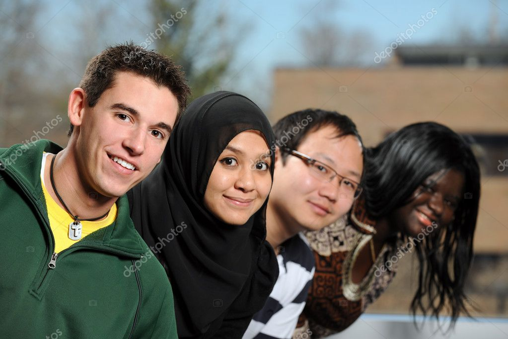 Diverse group of students smiling with selective focus on foreground person — Stock Photo #13720411