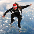 Stock Photo: Skateboarder Above the Clouds