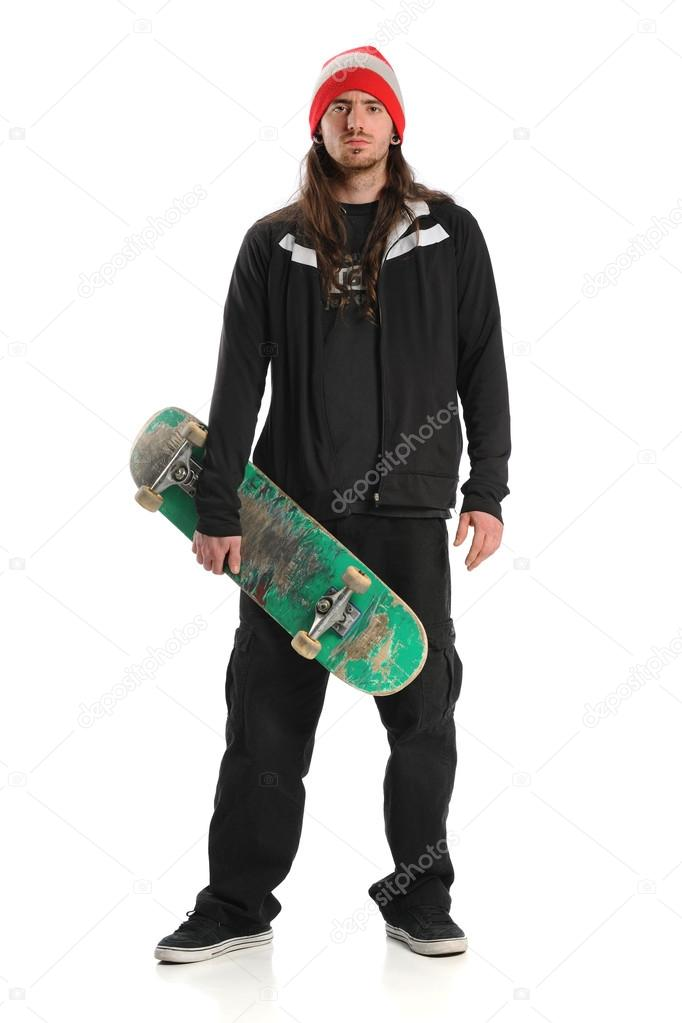 Portrait of skateboarder standing isolated over white background  Stock Photo #13812051