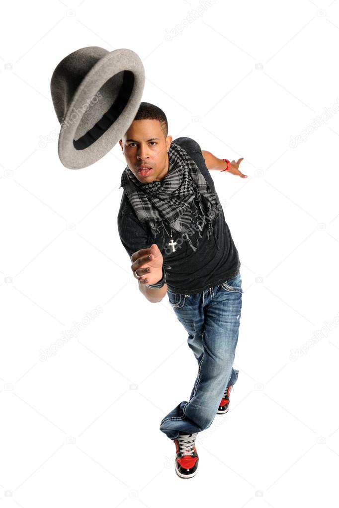African American hip hop dancer performing with hat isolated over white background  Stock Photo #13812123