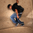Стоковое фото: Hip Hop MStanding on Wall