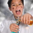 Young Mad Scientist Mixing Chemicals — Stock Photo #13993010