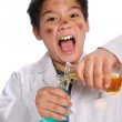 Young Mad Scientist Mixing Chemicals — Stock Photo #13993015