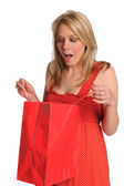 Woman Opening Gift Bag — Stock Photo