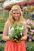 Young Woman Holding Plant — Stock Photo