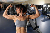 Woman Flexing at the Gym — Stock Photo