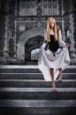 Young Woman Descending Steps of Castle — Stock Photo