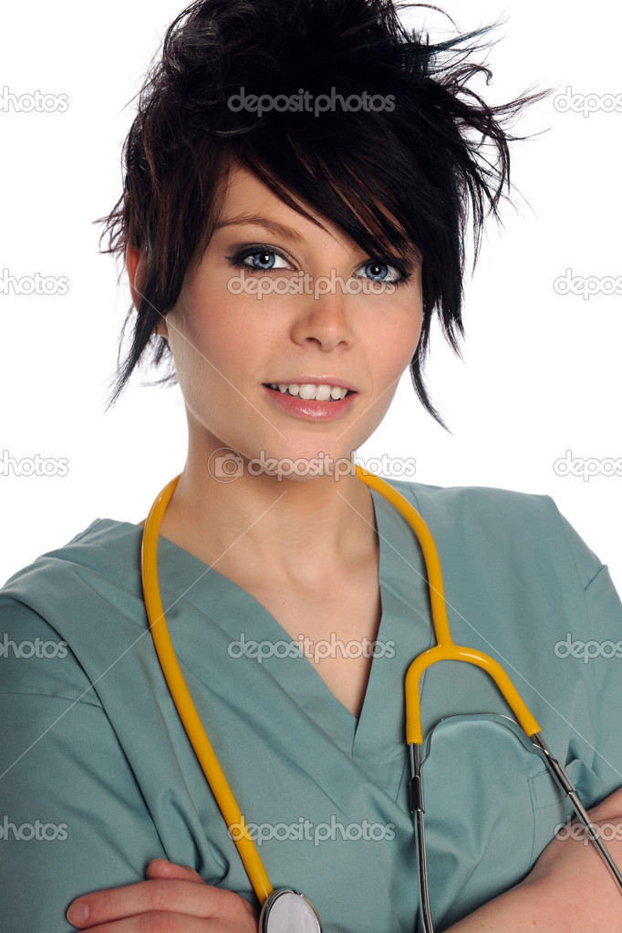 Beautiful young woman in scrubs isolated over white background — Stock Photo #13992311