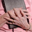 Stock Photo: Elderly Woman's Hand Holding Bible