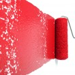 Roller With Red Paint on White Wall — Stock Photo