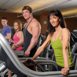 Stock Photo: Men and Women at Gym