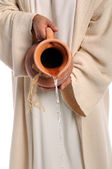 Hands of Jesus Pouring Water — Stock Photo